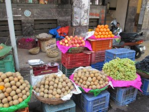 A fruit stall near MG road, you can see the vendor to the right at the back.