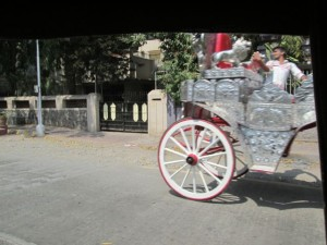Shot from the moving rickshaw; a wedding carriage.
